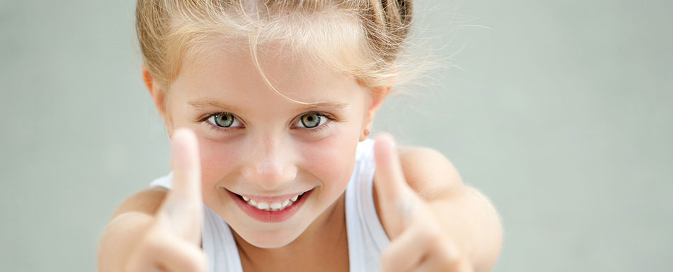 Girl with thumbs up - Pediatric Dentist in Temple, TX